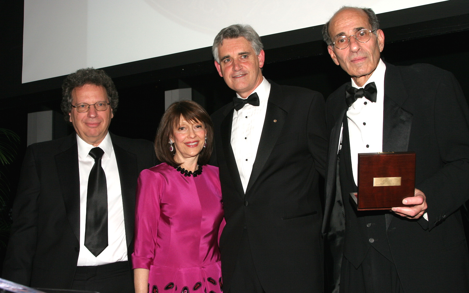The Double Helix Medals for Scientific Achievement were presented to Dr. Michael Wigler (far left), and Dr. Richard Axel (far right), at Cold Spring Harbor Laboratory's 2007 Double Helix Medals Dinner, November 8, 2007. Pictured with the honorees is Evelyn Lauder, who presented the awards, and Dr. Bruce Stillman, CSHL President