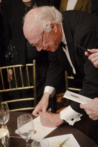 James D. Watson signing autographs