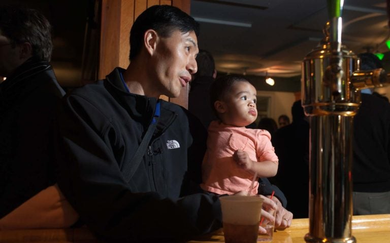 photo of father holding baby daughter at CSHL