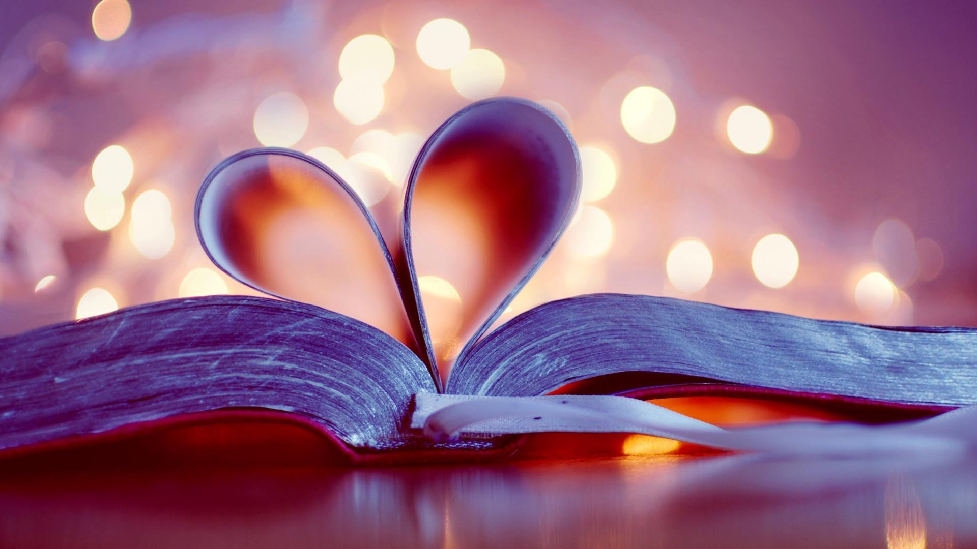 image of a book with pages curled into a heart