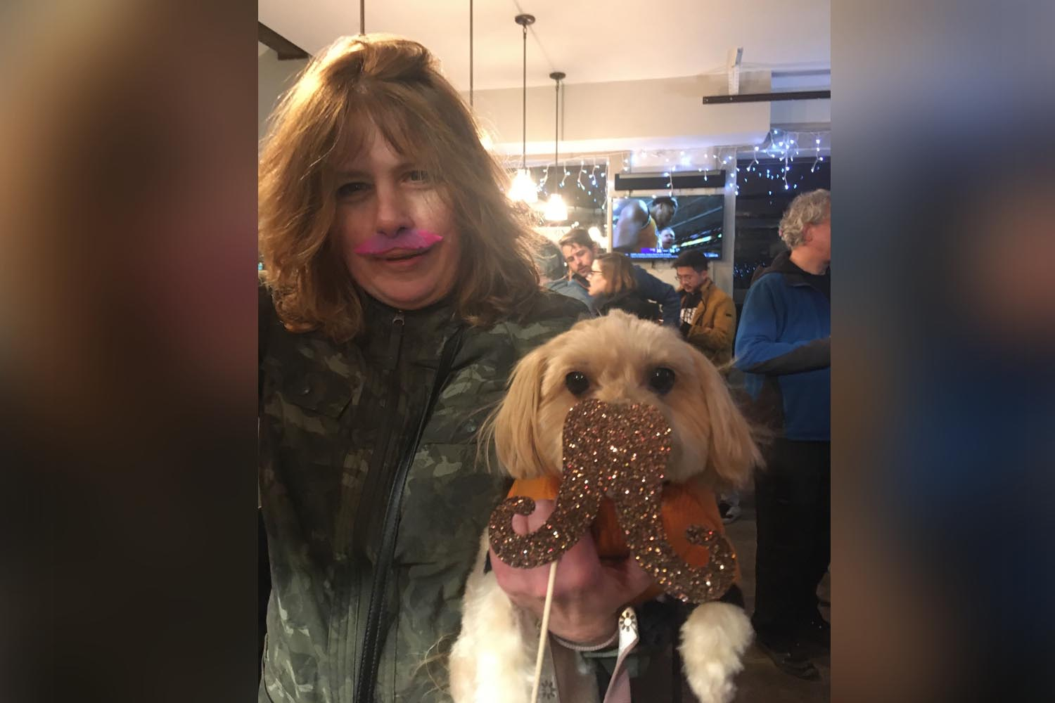 photo of Woman and her Dog sporting moustaches at Cocktails & Chromosomes Movember