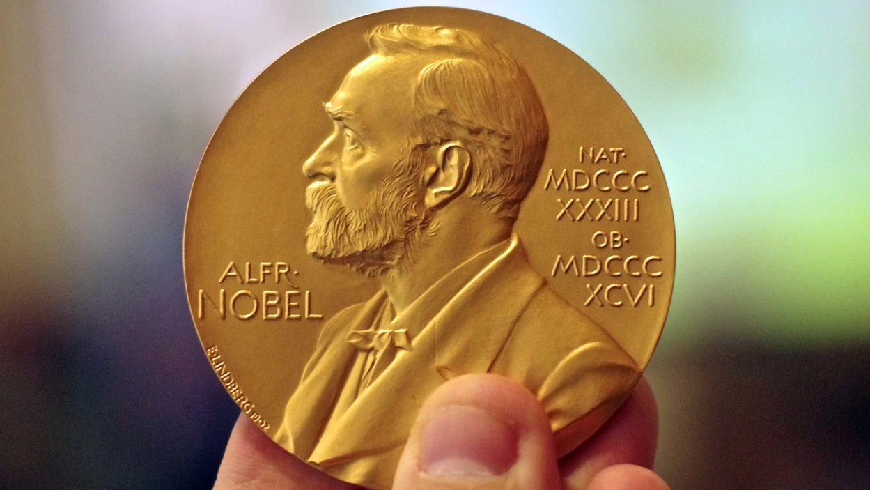 photo of person holding Nobel Prize