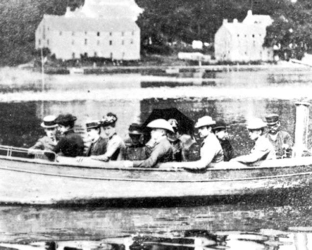 historic photo of the first students at the Brooklyn Institute Laboratory in a boat on the harbor circa 1890