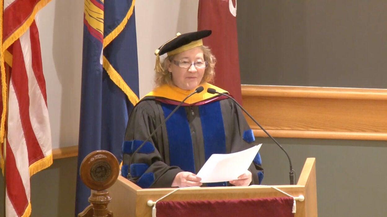 photo of Carol Greider behind podium during WSBS graduation 2017