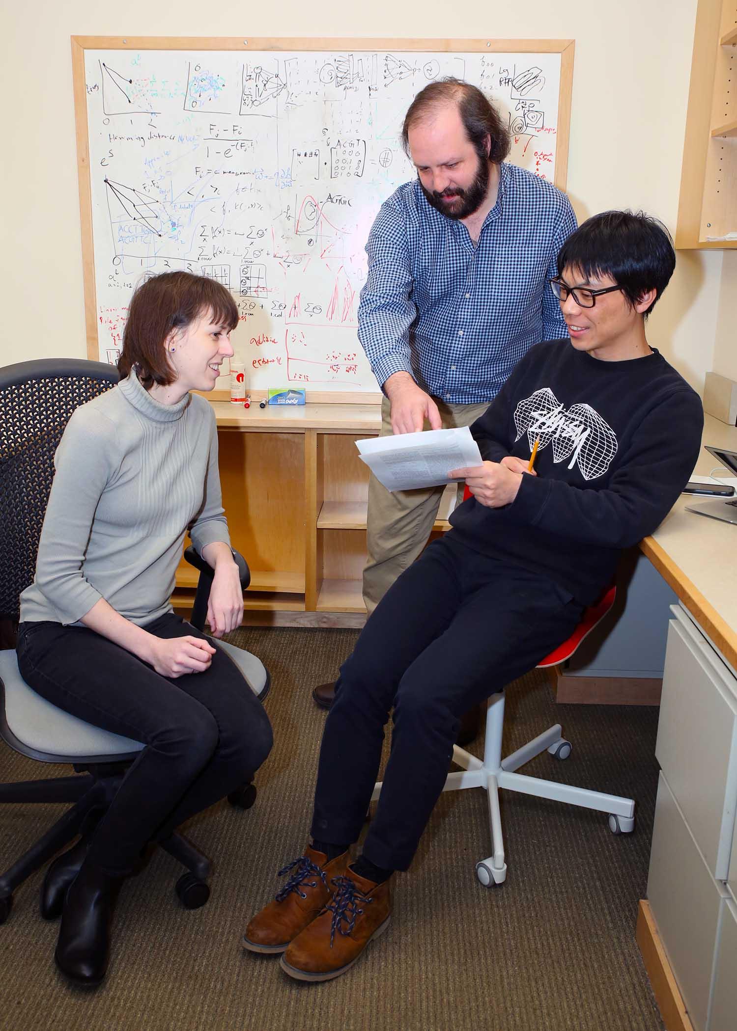 photo of David McCandlish Anna Posfai and Juannan Zhou in the lab