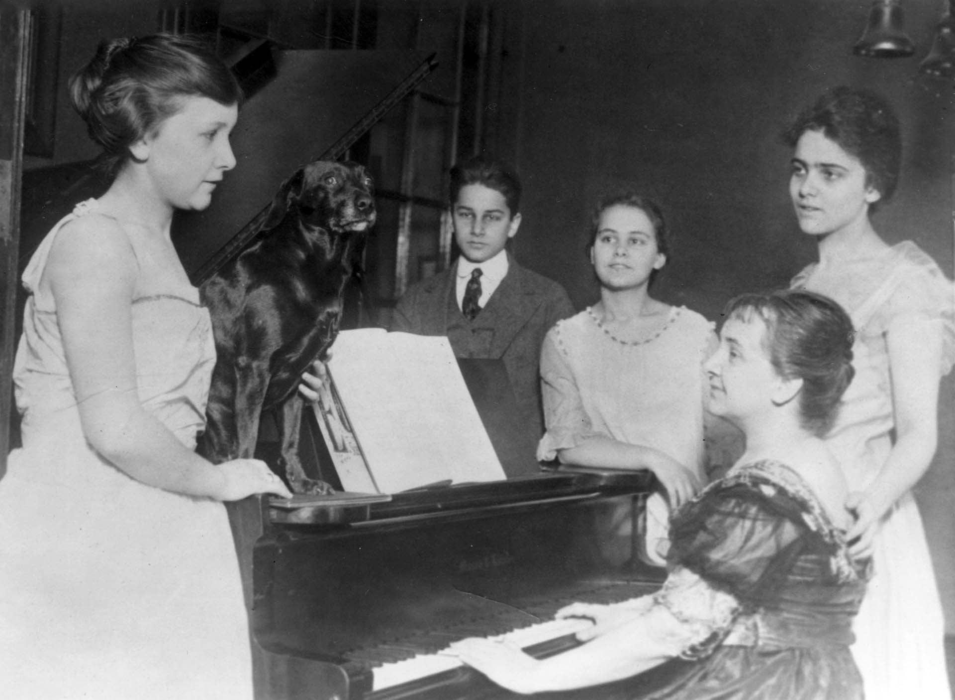 photo of McClintock family gathered around piano