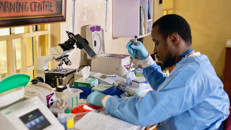 photo of Michael Okuru pipetting