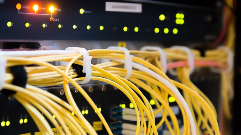 photo of network router and network cables in a data center