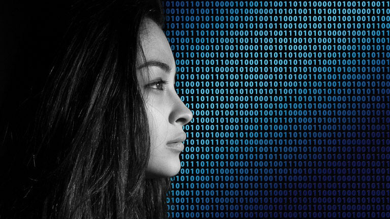 photo of woman in profile with binary code background