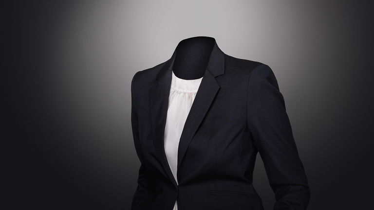 photo of a manakin wearing a black suit jacket