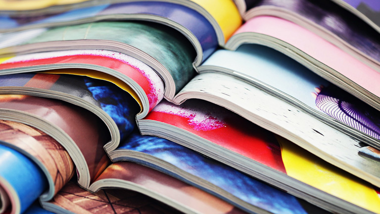 photo of a stack of open magazies