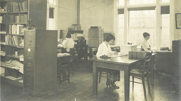 historic photo of people working in the Eugenics Records Office