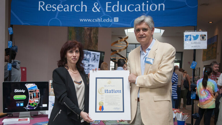 photo of Bruce Stillman holding a Citation