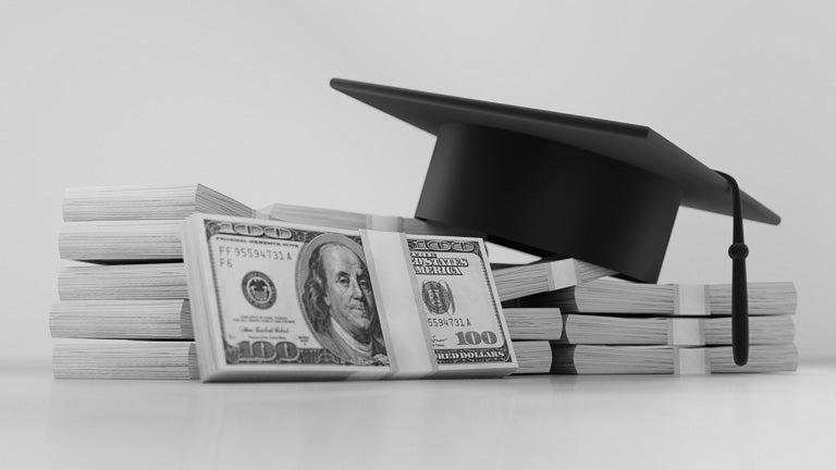 photo of cash with graduation cap