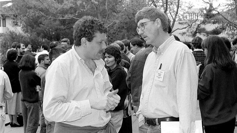 photo of Eric Lander and Francis Collins at a meeting at CSHL 1988
