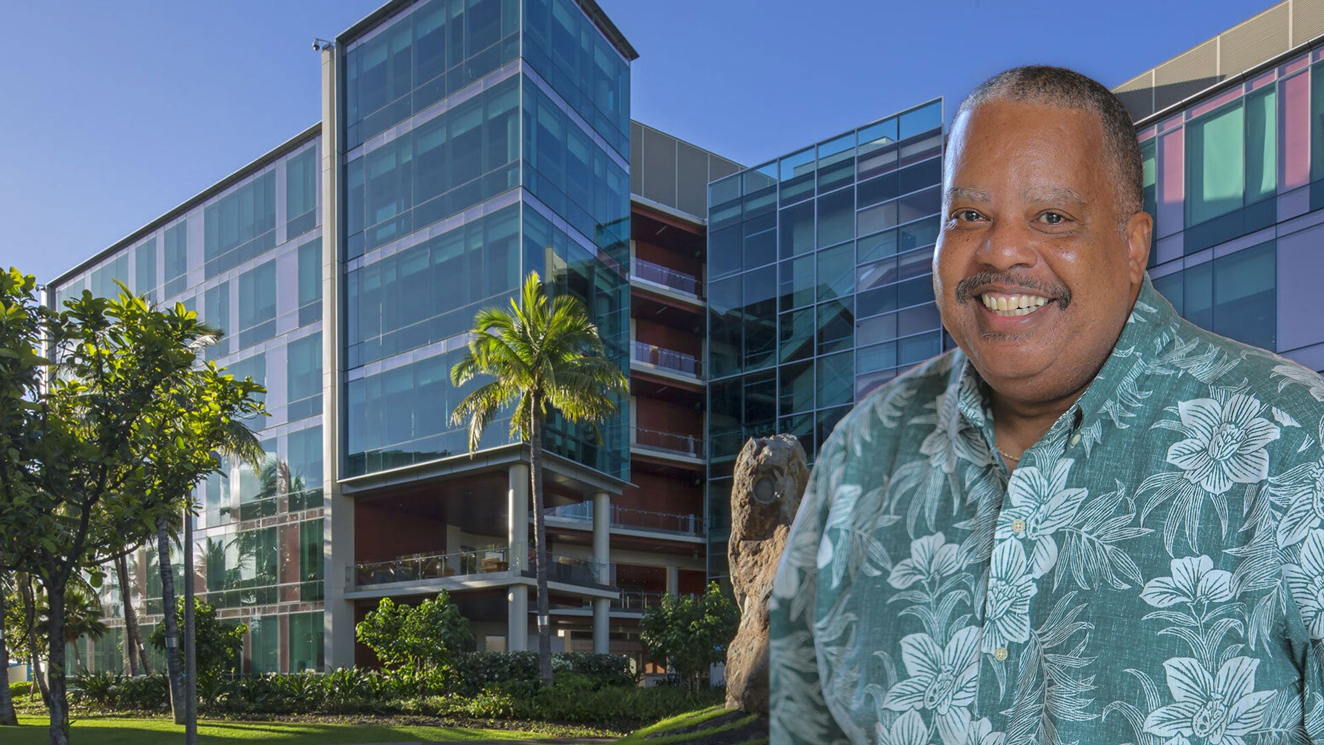 photo of Kevin Cassel in front of the University of Hawaii Cancer Center building
