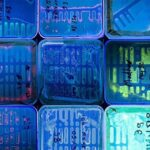 Photograph of several glowing agar plates arranged to look like Manhattan