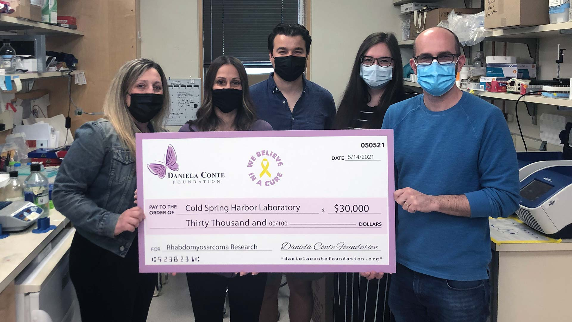 photo of the Conte Foundation check presentation to Chris Vakoc