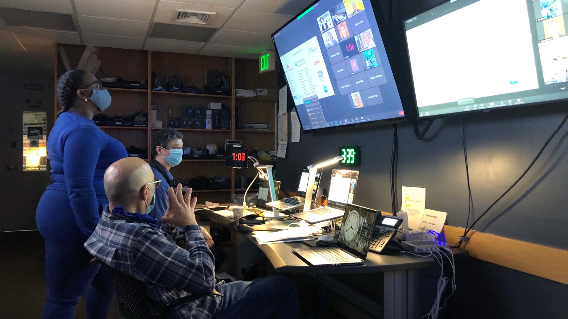 photo of the Meetings and Courses Program AV staff in control room