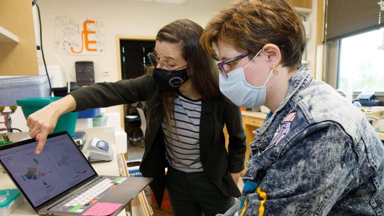photo of Hannah Meyer working in her lab
