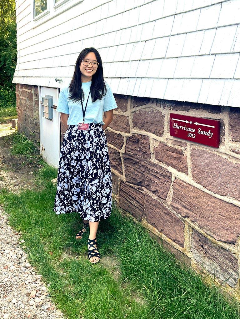 photo of Jasmine Lee standing next to Jones building