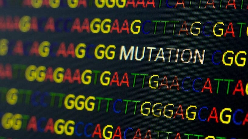 illustration of DNA sequence with colored letters on black background containing mutation