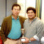 photo of Bob Tjian with Tiernan Cup in California